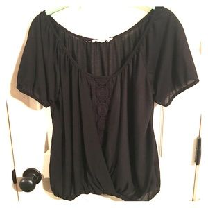 Black top with see through line in the front